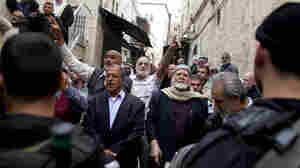 At A Tense Jerusalem Holy Site, Palestinians Stand Watch