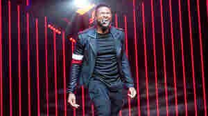 Usher performs onstage during his The UR Experience tour at Madison Square Garden.