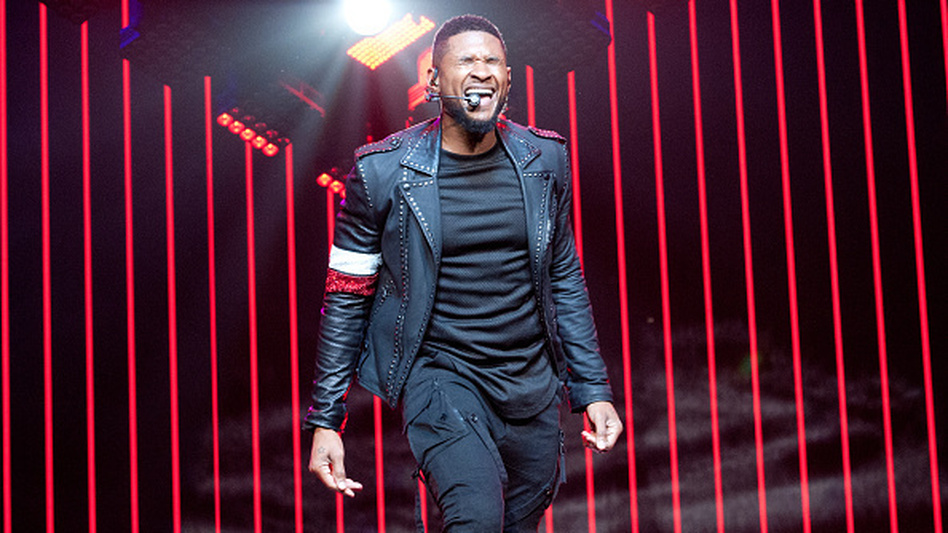 Usher performs onstage during his The UR Experience tour at Madison Square Garden. (Getty Images)