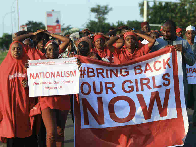"""#BringBackOurGirls"""" campaigners participate in a lamentation parade in Abuja, in early November, as more towns in Nigeria come under attack from Boko Haram."""