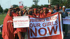 "#BringBackOurGirls"" campaigners participate in a lamentation parade in Abuja, in early November, as more towns in Nigeria come under attack from Boko Haram."