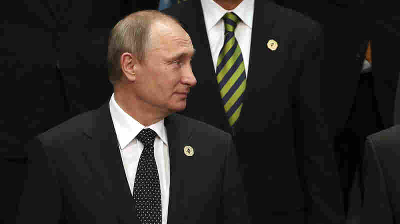 Russian President Vladimir Putin looks to his side during the family photo session of the G-20 summit in Brisbane, Australia, on Saturday. Putin was sternly  criticized by Western leaders over Moscow's involvement in eastern Ukraine.