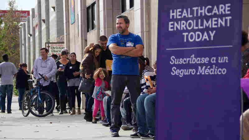 People wait to enter an Affordable Care Act enrollment event sponsored by SEIU-United Healthcare Workers West and Community Coalition in Los Angeles. Healthcare.gov's second enrollment period opened Saturday. More 100,000 people applied in the first day.