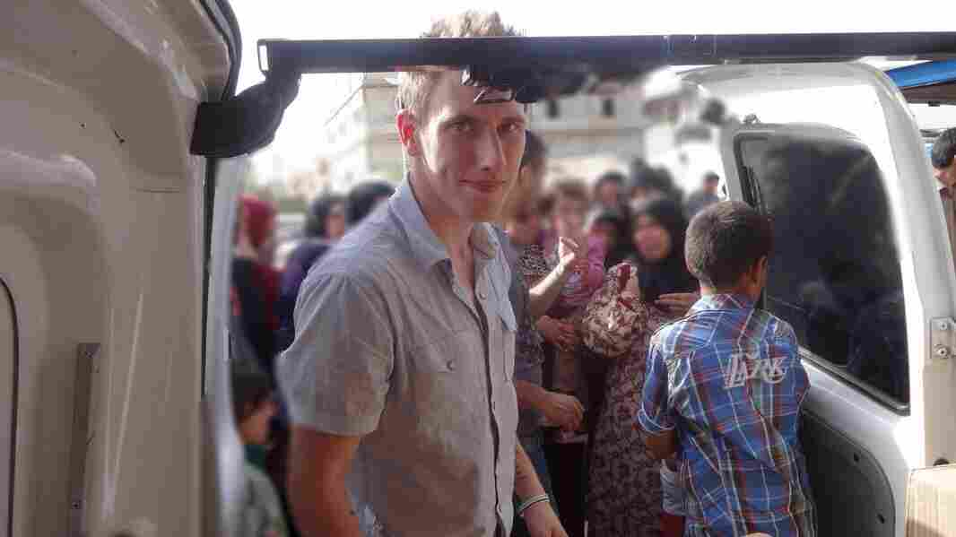 Peter Kassig, who changed his first name to Abdul-Rahman when he converted to Islam, is shown with a truck filled with aid supplies for Syrian refugees.