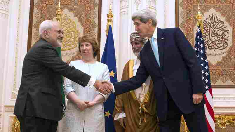 Secretary of State John Kerry (right) and Iranian Foreign Minister Javad Zarif shake hands as Omani Minister Responsible for Foreign Affairs Yussef bin Alawi and former EU top diplomat Catherine Ashton watch Nov. 9 in Muscat, Oman.