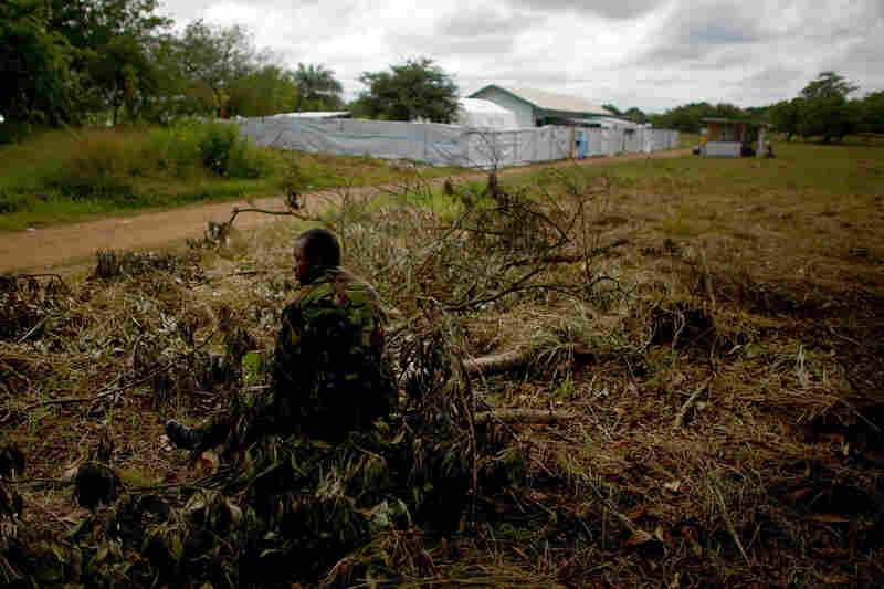 A soldier guards the road to the makeshift care center.