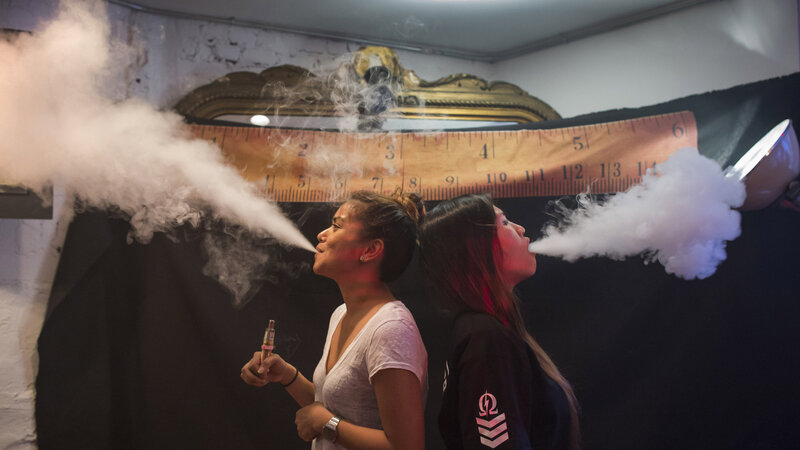 "Vape was chosen as the word of the year for 2014 in part because it provides a window ""onto how we define ourselves,"" says Casper Grathwohl of the Oxford University Press. Here, women exhale vapor clouds during a competition at the Henley Vaporium in Manhattan."