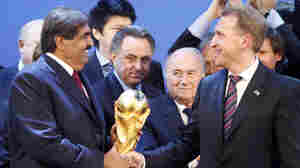 FIFA President Joseph Blatter (second right) is flanked in Zurich, Switzerland, on Dec. 2, 2010, by Russian Deputy Prime Minister Igor Shuvalov (right) and Qatar's Emir Sheikh Hamad bin Khalifa Al-Thani after the announcement that Russia will host the soccer World Cup in 2018 and Qatar in 2022.