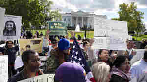 Activists rally for President Obama to use executive powers to act on immigration. Critics say the president would be going too far.
