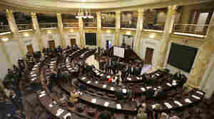 House members and those newly elected to the Legislature gather in the House chamber at the Arkansas state Capitol in Little Rock, Ark. Nov. 7, 2014. Arkansas' legislature is just one of 31 state legislatures in Republican control.