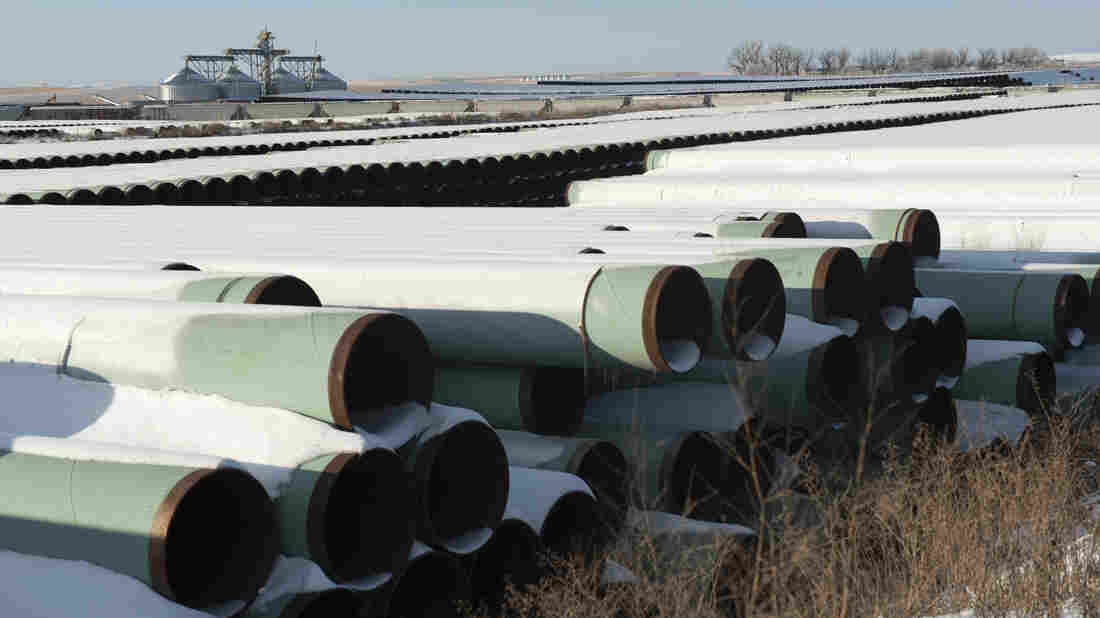 Pipes for Transcanada Corp.'s planned Keystone XL oil pipeline are stacked at a depot in Gascoyne, N.D. The House of Representatives approved the Keystone XL pipeline Friday; the Senate voted against it on Tuesday.