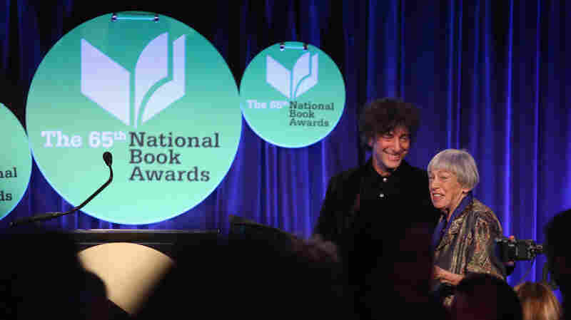 Neil Gaiman, left, and Ursula K. Le Guin attend the 2014 National Book Awards, where Le Guin was recognized, on Wednesday in New York City.