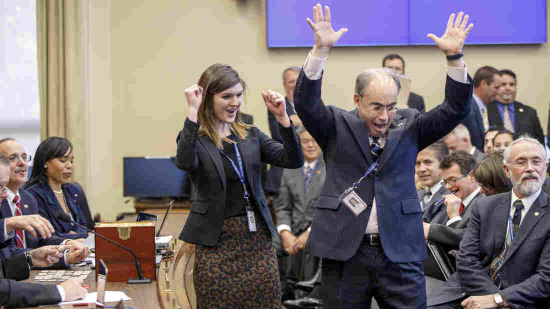 Rep.-elect Bruce Poliquin (right) of Maine celebrates after aide Megan Hutson picked a choice number in the congressional office lottery.