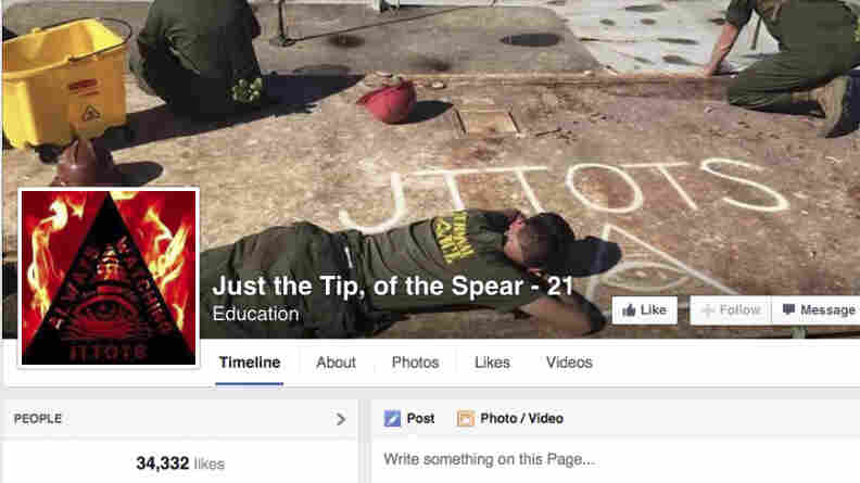 This Nov. 19 screenshot shows the cover photo of an unofficial Marine group on Facebook called Just the Tip, of the Spear. The group and those like it have been accused of promoting sexism and of acting as a forum for hate speech.