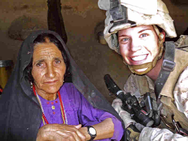 In this July 2012 photo, Cpl. Katherine Keleher (right) poses with a woman she met while on patrol in Sangin, Afghanistan. This photo appeared last fall on the Facebook page called Just the Tip, of the Spear, where members posted comments ridiculing the former Marine. The group is one of several unofficial Marine Facebook pages that have been accused of denigrating female service members.