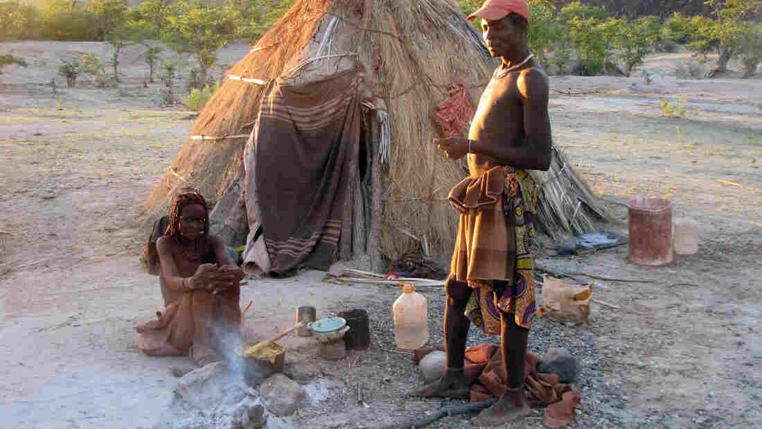 A couple from Namibia's Twe tribe outside their home. Tribe members took part in a study that examined the relationship between navigation skills and mating success.