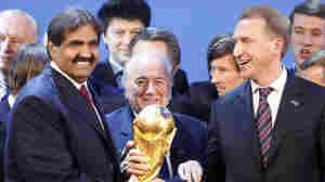 FIFA President Joseph Blatter is flanked by Russian Deputy Prime Minister Igor Shuvalov (right) and Qatari Emir Sheikh Hamad bin Khalifa Al-Thani on Dec. 2, 2010, in Zurich, Switzerland, after the announcement that Russia will host the 2018 World Cup and Qatar in 2022.