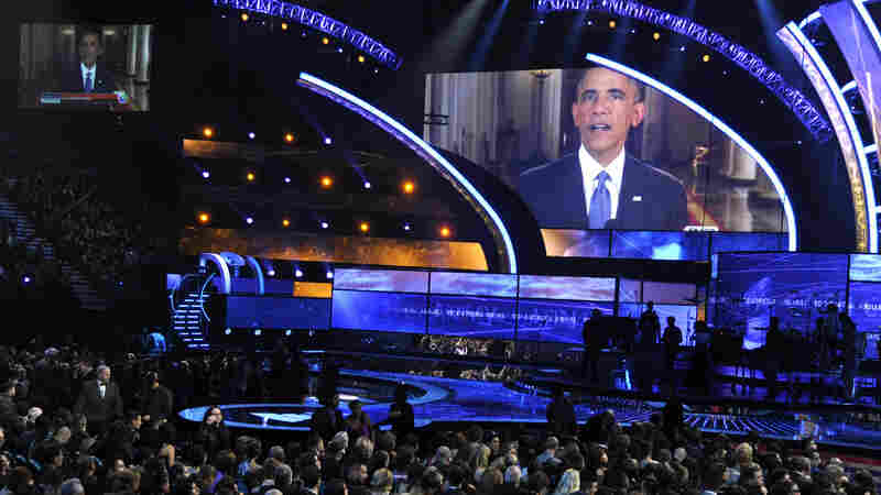 President Obama's immigration speech is displayed on large screens Thursday night at the 15th annual Latin Grammy Awards at the MGM Grand Garden Arena in Las Vegas. Obama will further discuss his plan Friday at a high school in the city.