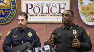 Tallahassee police chief Michael Deleo, left and FSU police chief David Perry talk with the media about a shooting at the Florida State University campus in Tallahassee, Fla. Thursday Nov 20, 2014.