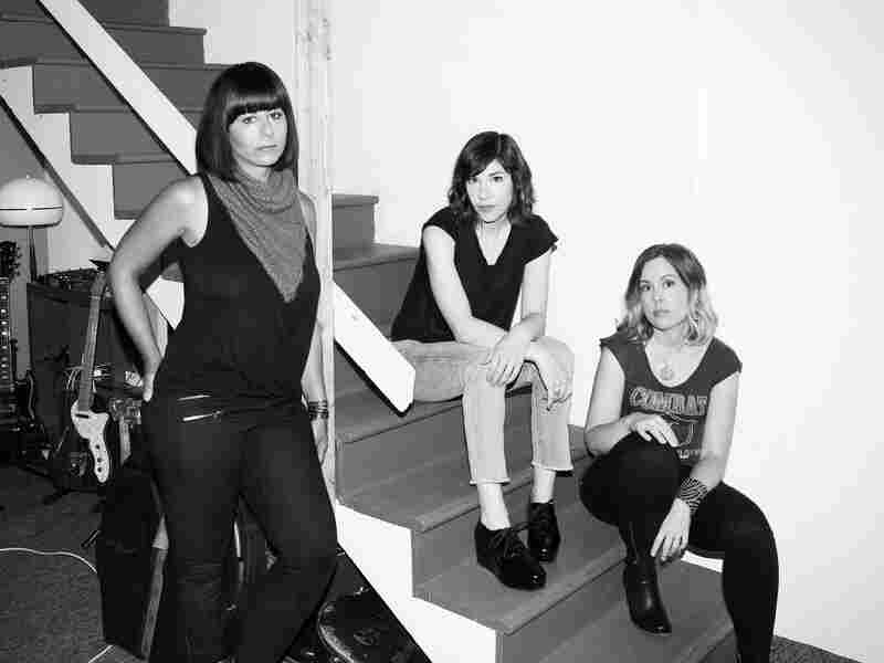 Sleater-Kinney's Janet Weiss (left), Carrie Brownstein (center) and Corin Tucker (right) join All Songs Considered hosts Bob Boilen and Robin Hilton to discuss new album No Cities To Love.