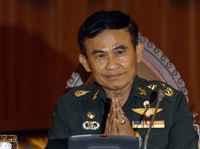 Thailand's Justice Minister Gen. Paiboon Koomchaya tells Reuters that martial law will remain in place