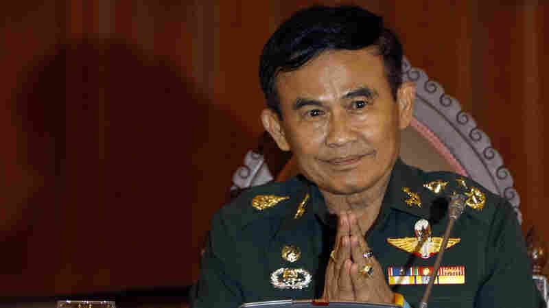"""Thailand's Justice Minister Gen. Paiboon Koomchaya tells Reuters that martial law will remain in place """"indefinitely."""""""