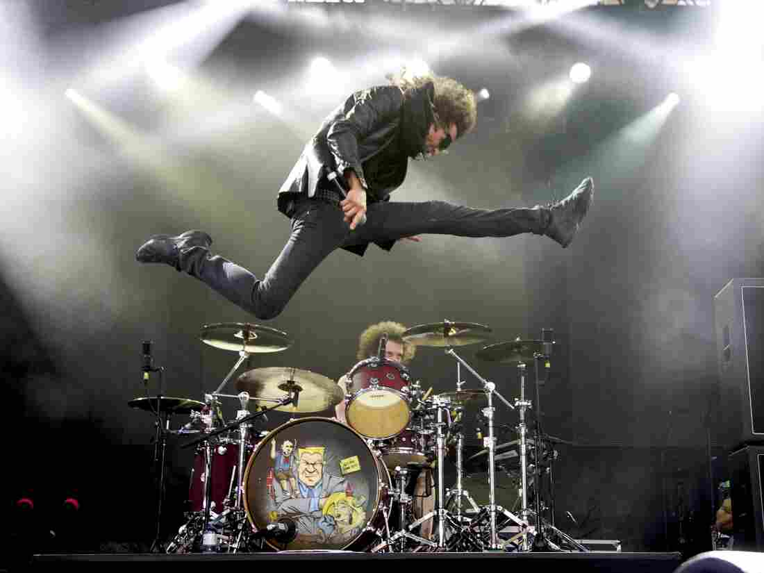 Singer Gary Cherone leaps over drummer Kevin Figueiredo during a performance by the band Extreme.