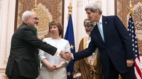 U.S. Secretary of State John Kerry (right) and Iran's Foreign Minister Javad Zarif (left) shake hands as Oman's Minister for Foreign Affairs Yussef bin Alawi (second from right) and the former EU top diplomat Catherine Ashton watch in Muscat, Oman on Nov. 9. Iran is holding talks with six world powers in Vienna this weekend in advance Monday's deadline for a deal on Iran's nuclear program.