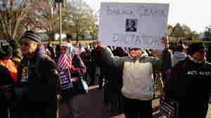 A demonstrator rallies against Obama's executive action on immigration across from the White House on Friday.