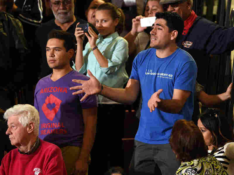 Angel Fernandez, left, and Jose Patino interrupt U.S. President Barack Obama's speech on U.S. immigration policy Friday at Del Sol High School on in Las Vegas. The two, who were brought to the United States as children and are protected from deportation by the president's policies, were upset that their parents still could be forced to leave.