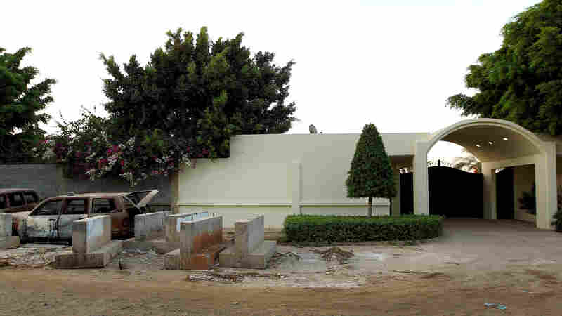 The 2012 attacks on U.S. facilities in Benghazi, Libya, happened without an intelligence failure, a House panel concludes. A photo from 2013 shows wreckage outside the main gate of the U.S. Consulate in Benghazi.