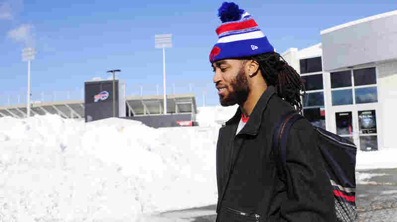 """Buffalo Bills cornerback Stephon Gilmore prepares to take the bus, leaving Ralph Wilson Stadium to play a """"home"""" game in Detroit. Tickets to the game, postponed to Monday, are free."""