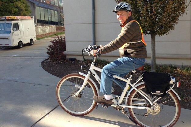 Joel Bowman, 66, rides his e-bike six miles daily to his job at Emory University in Atlanta.