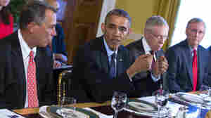 Even though they were sitting close together at a White House luncheon earlier this month, Democrats and Republicans remain far apart on many issues including immigration. From left are House Speaker John Boehner, President Obama, Senate Majority Leader Harry Reid and Senate Minority Leader Mitch McConnell.