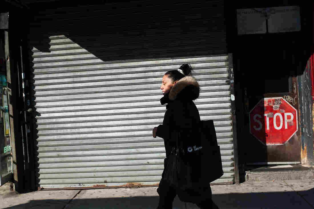 Norma Melendez, a community health worker with City Health Works, walks along Second Avenue on her way to meet a client. City Health Works is an organization that is attempting to bring an African model of health care delivery to the United States.