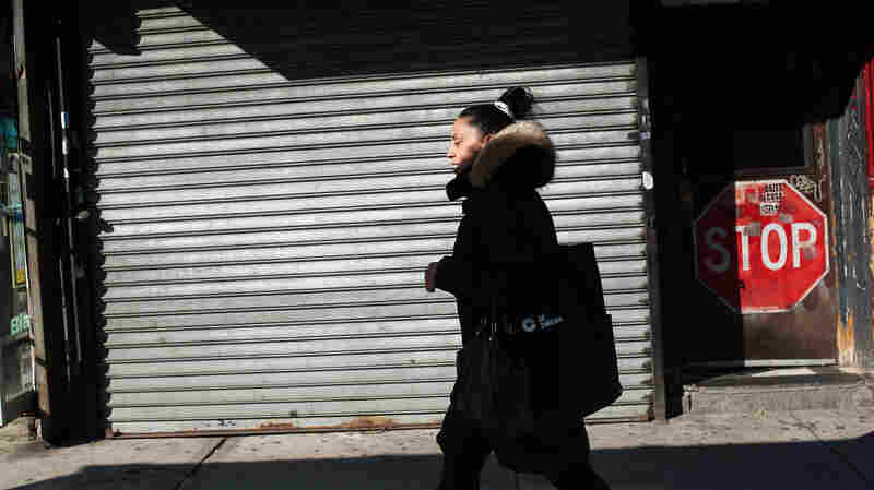 Norma Melendez, a community health worker with City Health Works, walks along 2nd Avenue on her way to meet a client. City Health Works is an organization that is attempting to bring an African model of health care delivery to the United States.