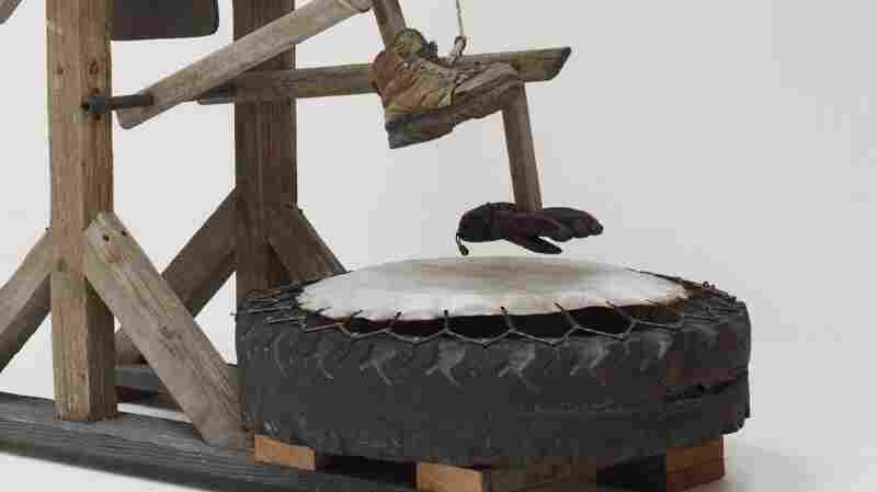 "Galindo's ""zapatello"" uses gears and cranks to hit a shoe and glove on a drum made of a tire and rawhide."
