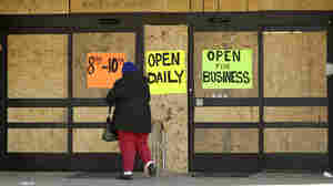 Some businesses in Ferguson have boarded up their windows in anticipation of the grand jury announcement whether to criminally charge Officer Darren Wilson in the killing of 18-year-old Michael Brown.