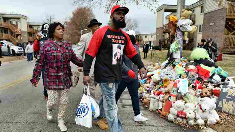 Michael Brown Sr., the father of 18-year-old Michael Brown who was shot dead by a police officer, distributes Thanksgiving turkeys Saturday to neighbors where his son was killed in Ferguson, Mo., this past August.