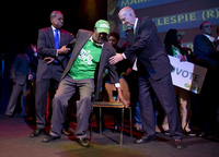 Former Washington Mayor Marion Barry, center, is helped to a chair on stage before the arrival of Washington Democratic mayoral candidate Muriel Bowser at the Howard Theatre in Washington, Tuesday, Nov. 4, 2014. Bowser is favored to continue her party's unbeaten streak for the city's top office in Tuesday's election. (AP Photo/Carolyn Kaster)