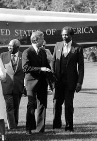 President Jimmy Carter talks with Mayor Marion Barry of on the South Lawn of the White House in 1980 just after arriving by helicopter from a weekend at Camp David.