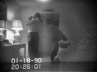 This frame from a black-and-white FBI videotape shows Barry allegedly lighting a crack cocaine pipe in a Washington hotel room on January 18, 1990 as Rasheeda Moore stands behind him. The tape was played on TV newscasts around the world.