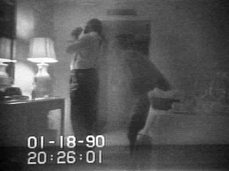 This frame from a black-and-white FBI videotape shows Barry allegedly lighting a crack cocaine pipe in a Washington hotel room in 1990. The video was played repeatedly on television newscasts around the world and used as evidence against Barry.