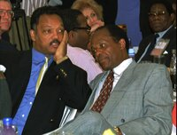 Jesse Jackson, left, co-head of the U.S. delegation talks with Washington mayor Marion Barry Wednesday July 23 1997 during a luncheon held for the delegates to the fourth African-African American Summit held in Harare. (AP Photo/Cobus Bodenstein)