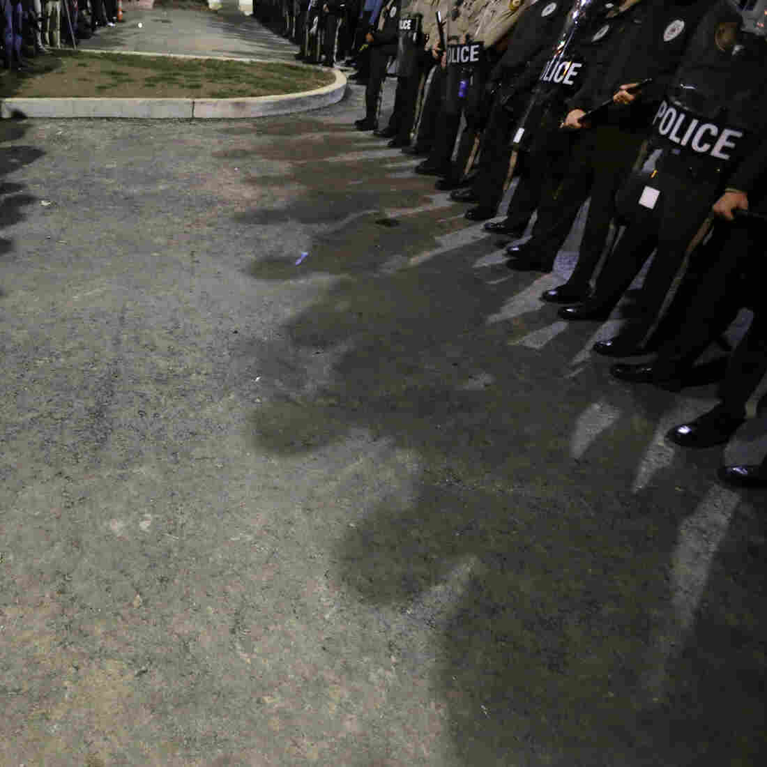 Protesters and law enforcement officers face off during a protest outside the Ferguson Police Department in October. Ferguson police statistics show the department arrest blacks at a higher rate than other racial groups — but that disparity is true for police departments across the country.