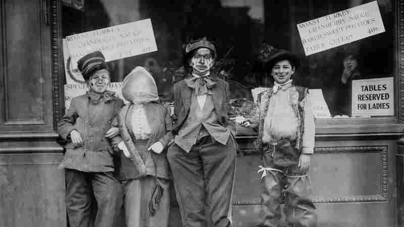 Thanksgiving maskers, circa 1910-1915.