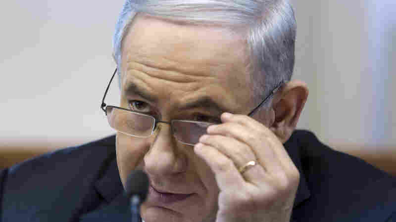 """Israeli Prime Minister Benjamin Netanyahu listens during a Cabinet meeting in Jerusalem on Sunday. His Cabinet approved a draft law that defines the country as """"the nation-state of the Jewish people."""""""