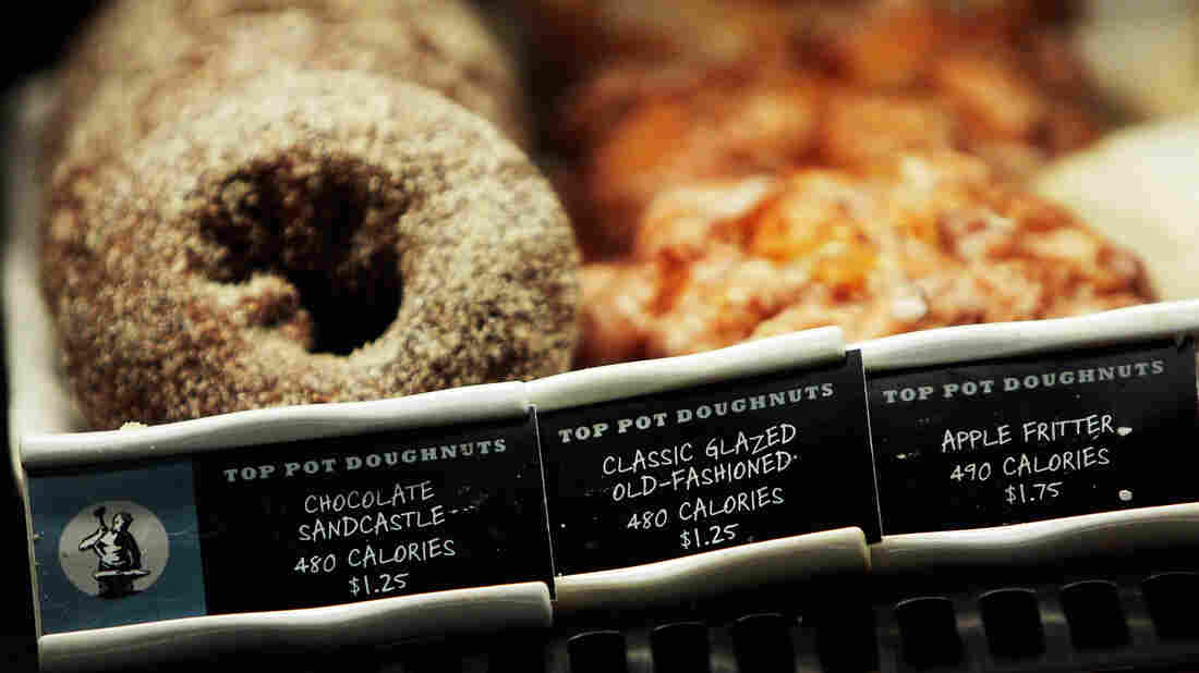 How many calories in that doughnut? A Starbucks coffee shop in New York City displays calorie information next to menu items. New FDA rules will require all chain restaurants and similar eating establishments to post calorie labels.
