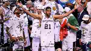San Antonio Spurs forward Tim Duncan celebrates with his teammates after defeating the Miami Heat in game five of the NBA finals in June.