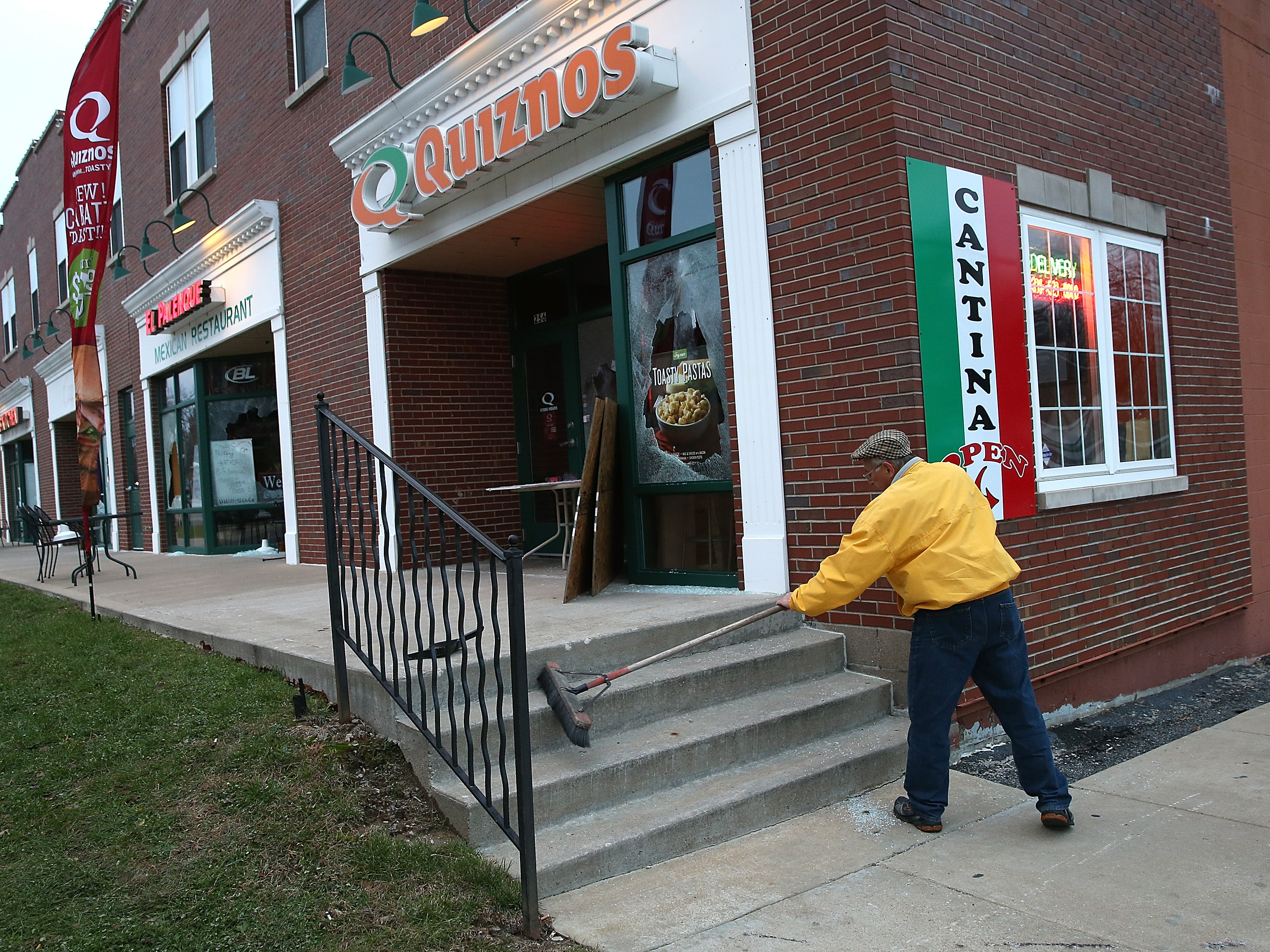 At Vandalized Ferguson Businesses, Anger And Tears